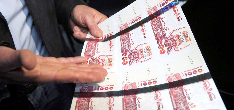 صورة طبع 570 ألف مليار دينار لإنقاذ الاقتصاد الوطني