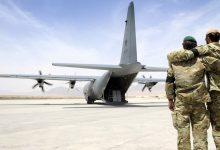 صورة جدل حاد بين كانبيرا وبكين حول صورة جندي أسترالي يضع سكينا على رقبة طفل أفغاني
