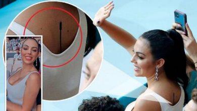 """صورة ما سر """"الميكرفون"""" على ظهر صديقة رونالدو خلال حضورها مباراة البرتغال وبلجيكا"""